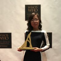Ho Receives Award from Who's Who in Asian American Communities